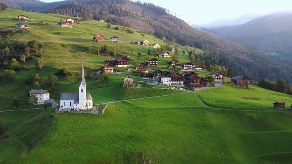 Thumbnail for Aerial View of Villas and Church on Austrian Mountains