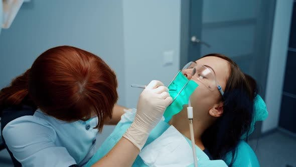 Thumbnail for Woman patient with toothache during tooth treatment