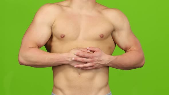 Thumbnail for Spasm in Abdominal Muscles of Athletic Man. Green Screen, Closeup