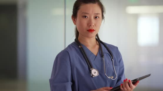 Thumbnail for Chinese millennial nurse or medical doctor using tablet computer in hospital