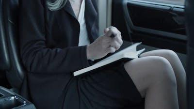 Closeup of Notebook in Businesswomans Hands