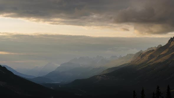 Thumbnail for Light Beams Illuminating Mountain Peaks at Sunset in Valle