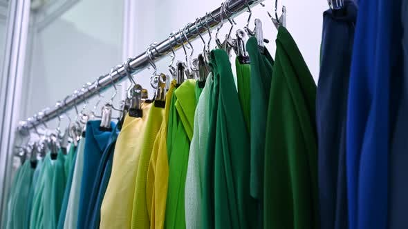 Factory Samples of Multicolored Fabrics Hang on a Hanger