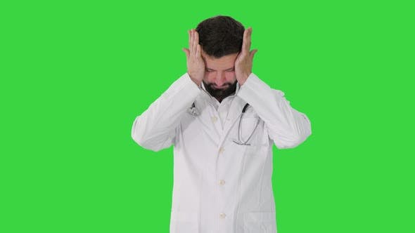 Thumbnail for Tired Turk Doctor Holding Face Despair Green Screen Chroma Key