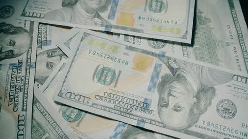American 100 Dollar Banknotes are Rotating on the Table Close Up