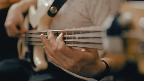 Fingers Pinch Chords on the Strings