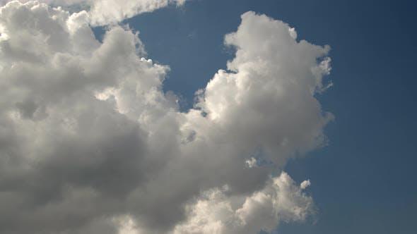 Speedy Cumulus Rain Clouds Moving Across Blue Sky
