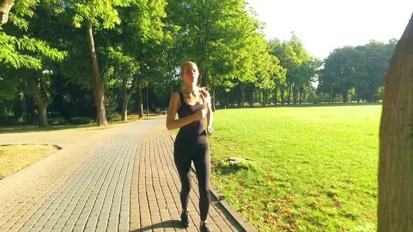 Thumbnail for Runner Woman Running In Park Exercising Outdoors