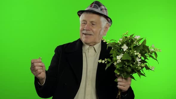 Thumbnail for Elderly Caucasian Grandfather Man with Bouquet of Flowers and Ring Goes on Date