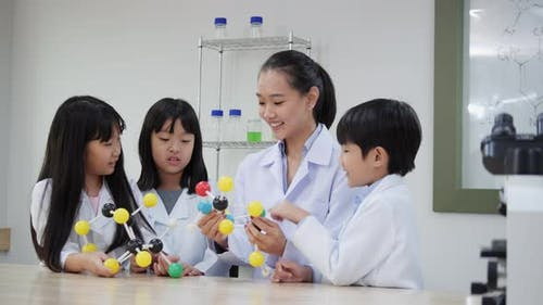 Student studying science in classroom.