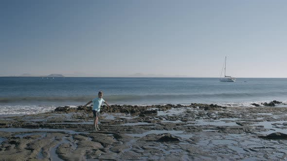 Child Walking on the Black Sand Beach of Lanzarote, Canary Islands