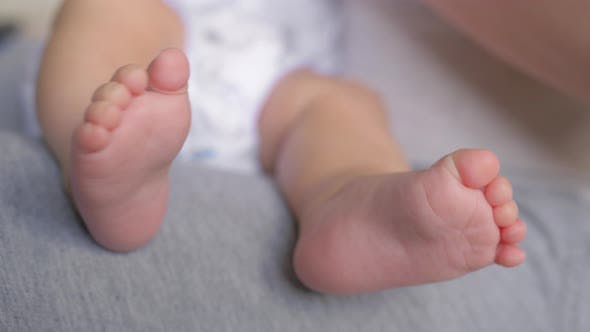 A close up of a baby feet