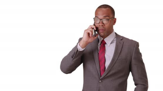Thumbnail for A black man uses his mobile phone for business on a white background