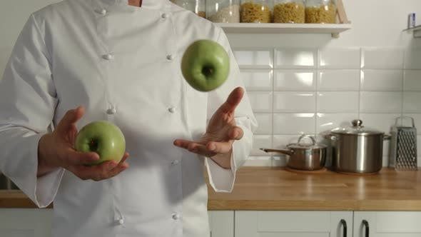Thumbnail for Chief-Cooker Juggles A Green Apples In A Kitchen