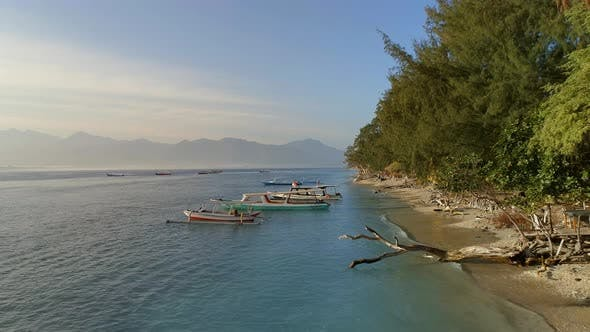 Picturesque Beach with Fishing and Tour Boats Moored to the Shore