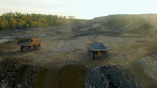 Thumbnail for Unloading Land From Quarry Dump Trucks
