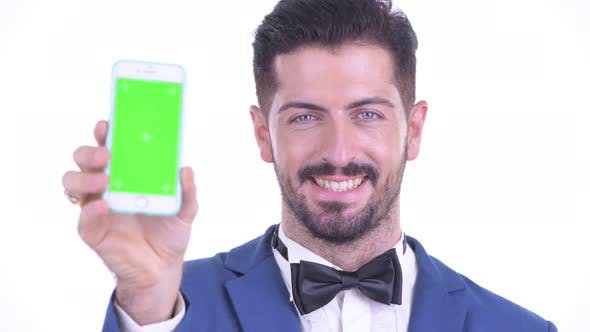 Thumbnail for Face of Happy Young Bearded Businessman Showing Phone