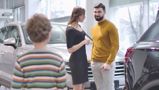 Thumbnail for Young Caucasian Husband and Wife Showing Car Keys To Their Son