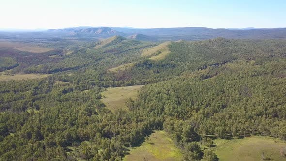 Thumbnail for Aerial Shot Flying Over a Mountainous Forest