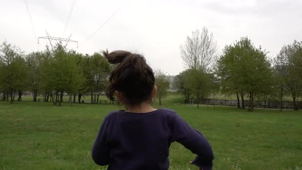 Child Running in the Park