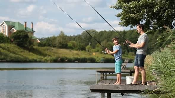 Thumbnail for Dad and Teenage Boy Angling Together on Lake
