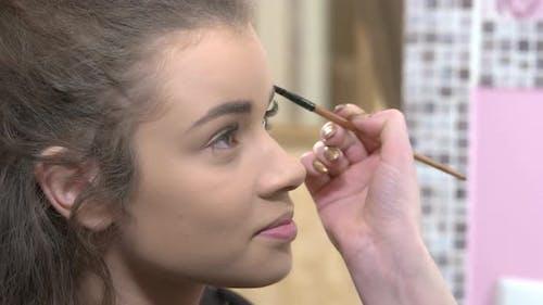 Hand of Makeup Artist Working