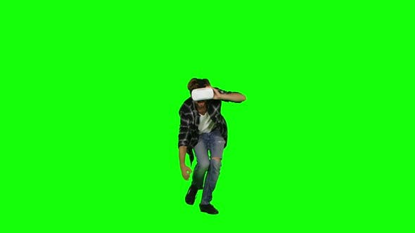 Thumbnail for Male Wearing a Mask of Virtual Reality on His Head. Green Screen