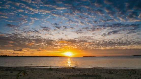 Thumbnail for Time lapse: sunrise over tropical beach and sea colorful dramatic sky