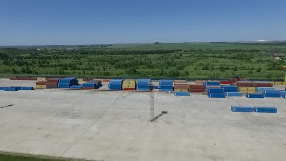 Containers Stacked at Storage Area with Gantry Crane, Aerial View