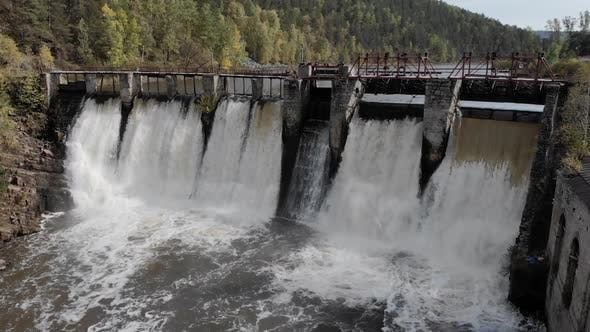 Water Spills Over the Top of Dam on the River