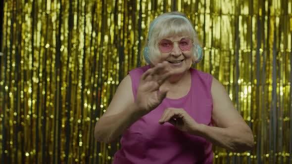 Thumbnail for Friendly Senior Old Woman Waving Hands Looking at Camera with Toothy Smile, Saying Hi, Greeting
