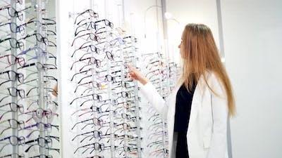Various of eye glasses in the shop. Eyeglasses on display shelves in glasses store