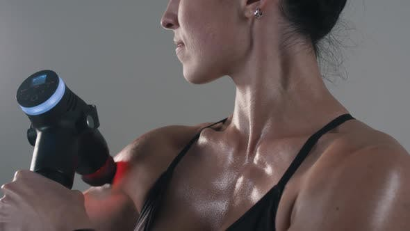 Thumbnail for Athletic Girl Uses Muscle Massager