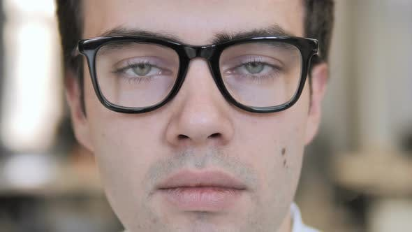 Thumbnail for Close Up of Serious Man Face in Glasses