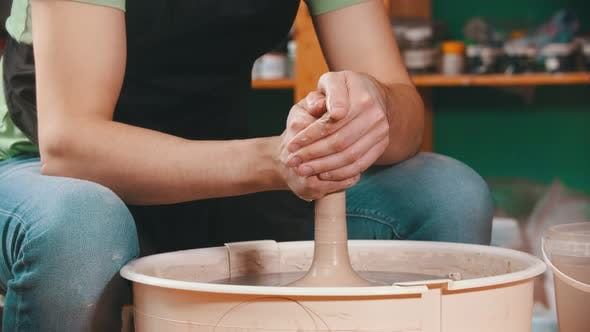 Thumbnail for Pottery - Potter Master Is Compressing Clay with Both Hands