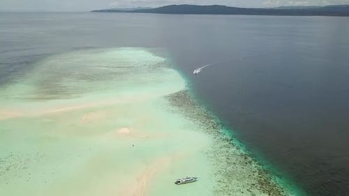 People and Boats on the Sandbank of a Tropical Sea