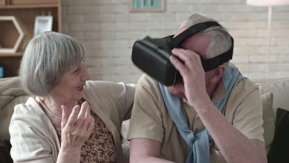 Thumbnail for Gesturing Elderly Man in VR Headset
