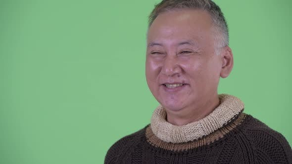 Thumbnail for Face of Happy Mature Japanese Man Thinking Ready for Winter