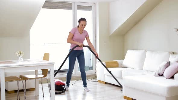 Thumbnail for Woman or Housewife with Vacuum Cleaner at Home