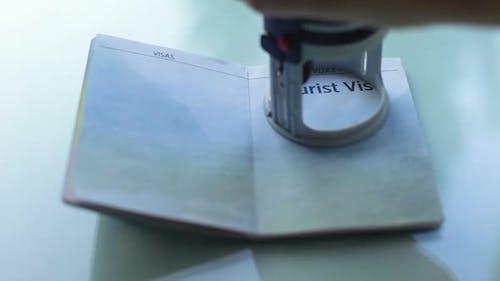 Tourist Visa Granted, Customs Officer Hand Stamping Seal in Passport, Travel