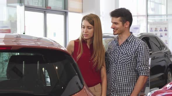 Thumbnail for Beautiful Couple Examining New Automobile at the Dealership