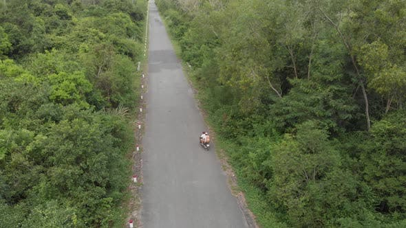 Thumbnail for Aerial: couple riding scooter inland Cat Ba island, travel destination in Vietnam