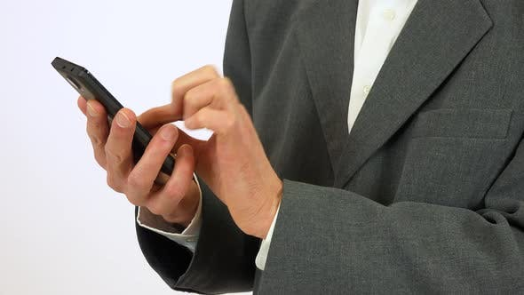 Thumbnail for An Elderly Man Works on a Smartphone - Closeup on the Hands From the Side - White Screen Studio