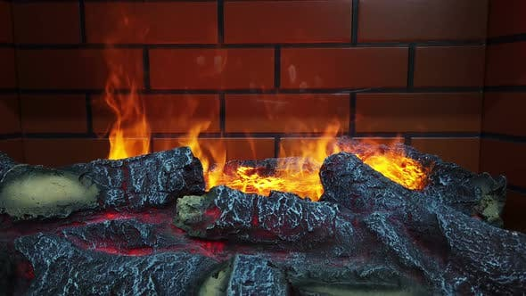 Cover Image for an Artificial Fire Burns in the Fireplace with Wood
