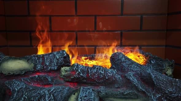 Thumbnail for ein künstliches Feuer brennt im Kamin mit Holz