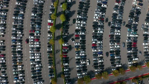 Aerial Top View of the Supermarket Parking Lot with Lots of Cars.
