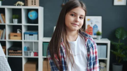 Slow Motion Portrait of Adorable Girl Smiling and Looking at Camera in Cozy Children's Room