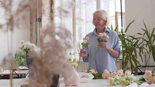 Thumbnail for Middle-aged Female Florist Working