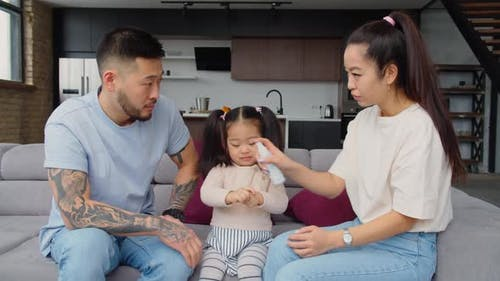 Asian Parents Educating Baby Daughter to Hygiene