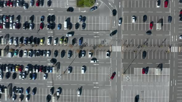 Thumbnail for Top down aerial view of cars using a busy car park